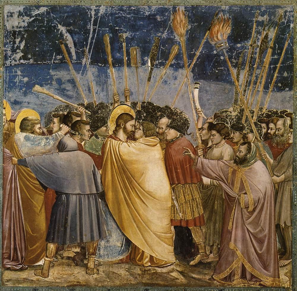 Judas, de 13de leerling, verraadt Jezus met een kus. Schilderij van Giotto di Bondone. © WikiCommons