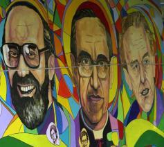 Een muurschildering in El Slavador met de beeltenis van de vermoorde jezuïeten © ANSA-VaticanNews