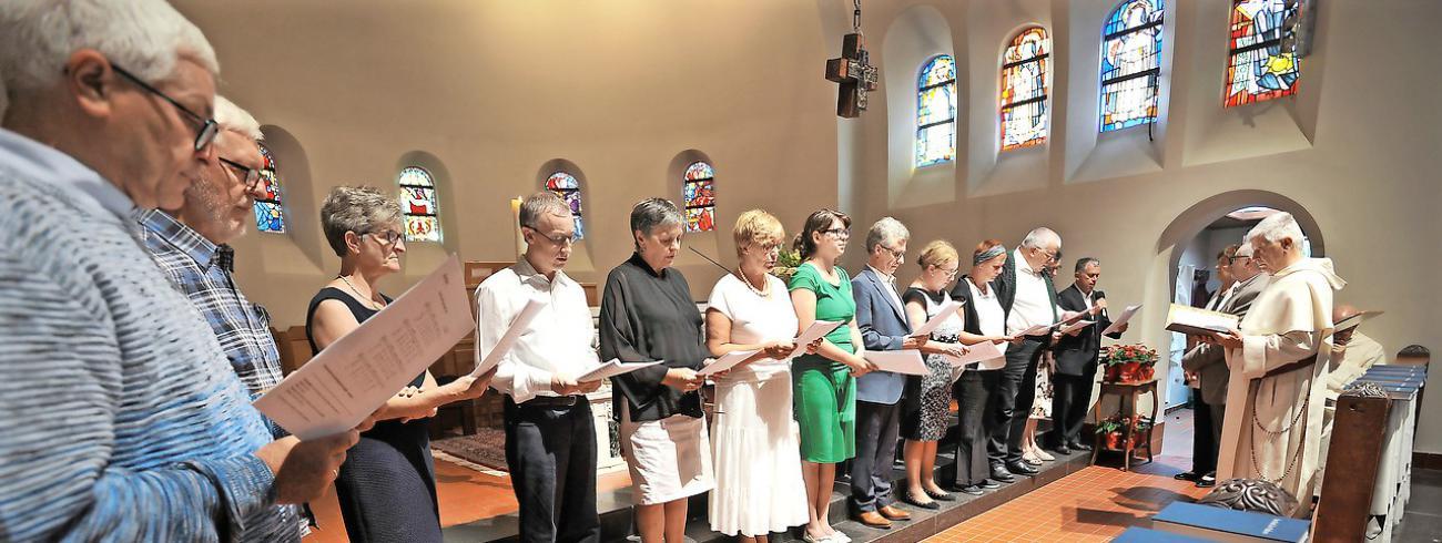 Veertien leken leggen hun dominicaanse gelofte af. © Violet Corbett Brock