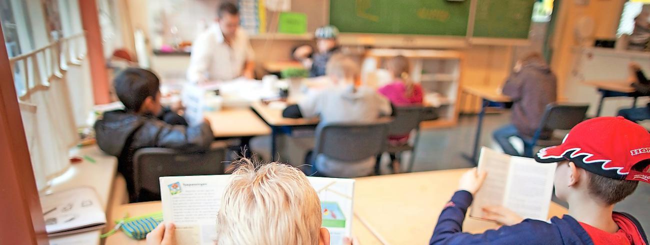 Kinderen uit het buitengewoon onderwijs torsen vaak een complex rugzakje.  © Belga Image