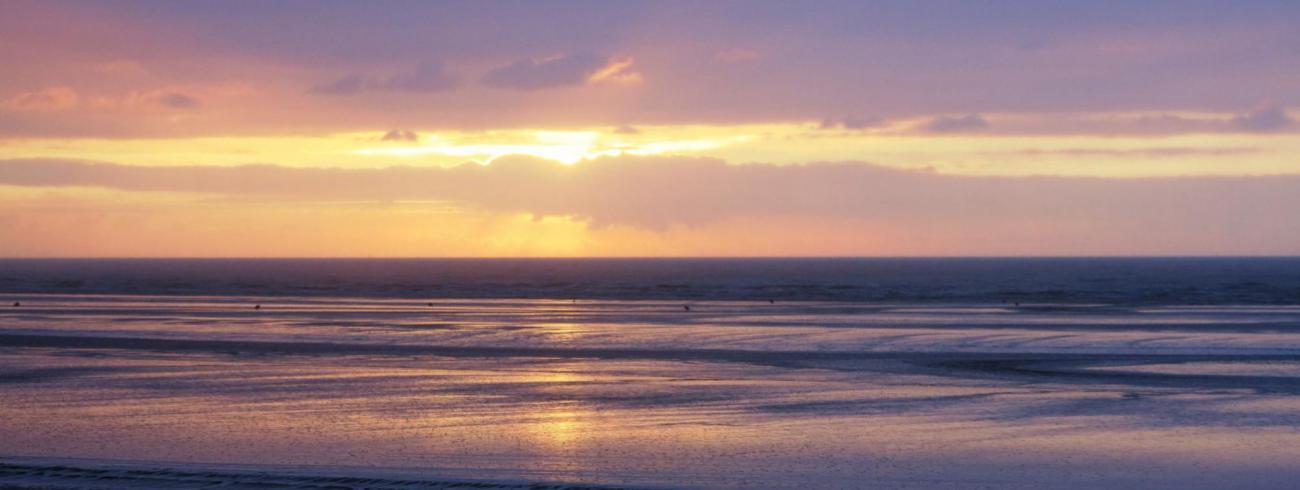 Een natte zonsondergang in De Panne. © Lust