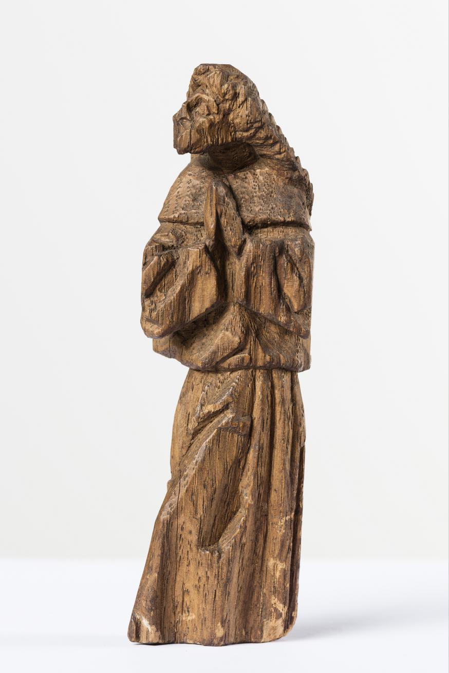 Het originele biddende figuurtje dat Borman in het retabel verstopte © KIK-IRPA