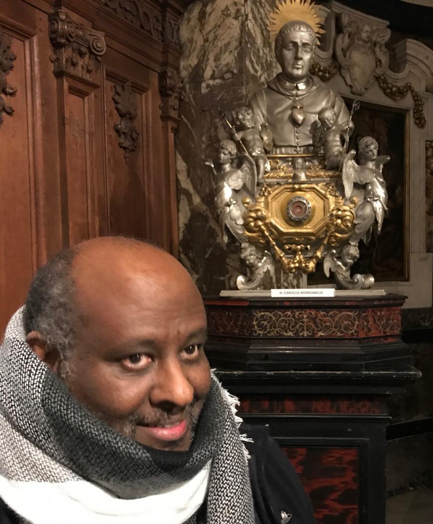 Don Mussie Zerai Yosief bij zijn bezoek vorig jaar aan de Sint-Carolus Borromeuskerk in Antwerpen © Benoit Lannoo