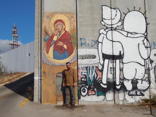 Pieter Stevens aan de scheidingsmuur tussen Israël en Palestina  © Pieter Stevens