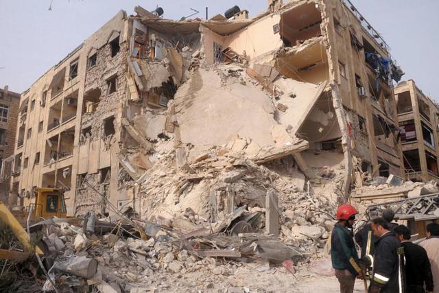Beschoten gebouw in Aleppo © SIR