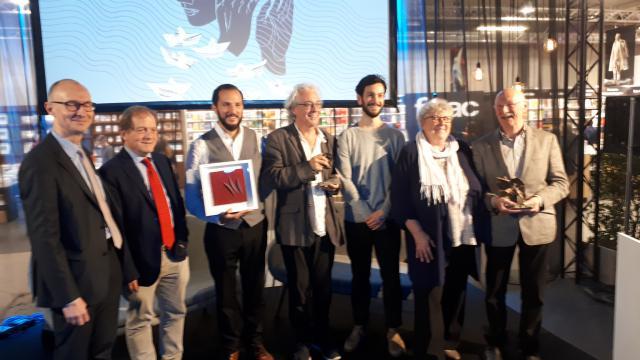 De drie prijswinnaars met de leden van de jury © Philippe Keulemans